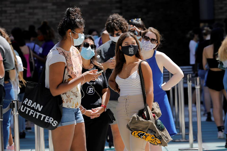 Students wear protective masks as they wait in line at a testing site for the coronavirus disease (COVID-19) set up for returning students, faculty and staff on the main New York University (NYU) campus in Manhattan, New York City, New York, U.S., August 18, 2020. REUTERS/Mike Segar