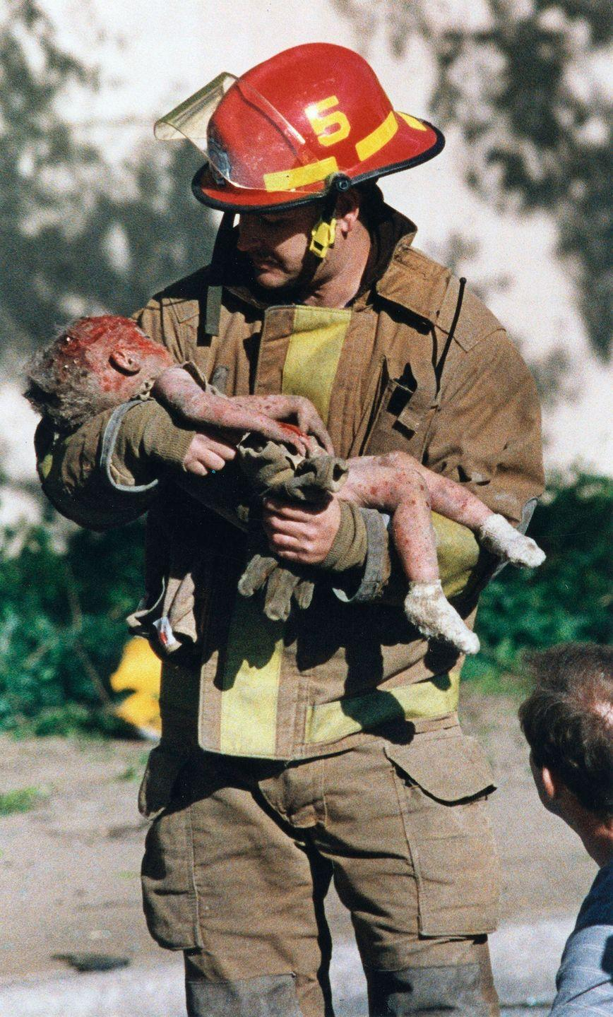 <p>1995. Firefighter Chris Fields carries Baylee Almon from the Alfred P. Federal Building in downtown Oklahoma City. Almon later died from her injuries sustained in the blast.</p>