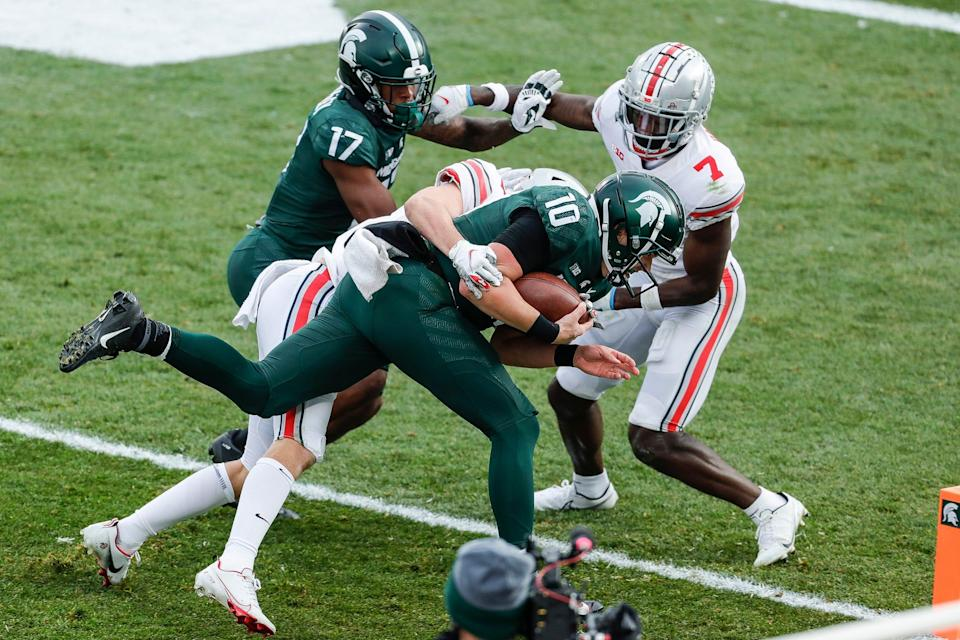 Michigan State quarterback Payton Thorne (10) scores against Ohio State during the second half at the Spartan Stadium in East Lansing on Saturday, Dec. 5, 2020. It was just one of two rushing touchdowns in the 2020 season for the Spartans, neither by a running back.