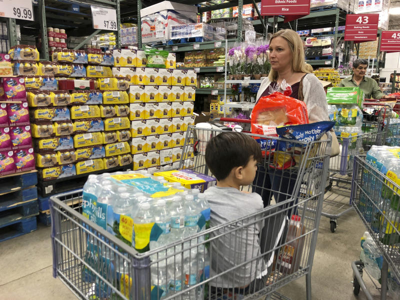 Tiffany Miranda of Miami Springs stands in line with supplies at a BJ's Wholesale Club Aug. 29, 2019, in Hialeah, Fla. (Photo: Marcus Lim/AP)