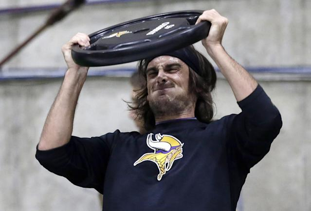 FILE - In this May 1, 2013, file photo, Minnesota Vikings punter Chris Kluwe lifts a weight during conditioning workouts for the NFL football team in Eden Prairie, Minn. Kluwe, who is no longer with the Vikings, says the team's special teams coordinator, Mike Priefer, made anti-gay comments while Kluwe was with the team. The Vikings issued a statement saying they take the allegations seriously. They also say he was released because of his football performance, not something else. (AP Photo/Jim Mone)