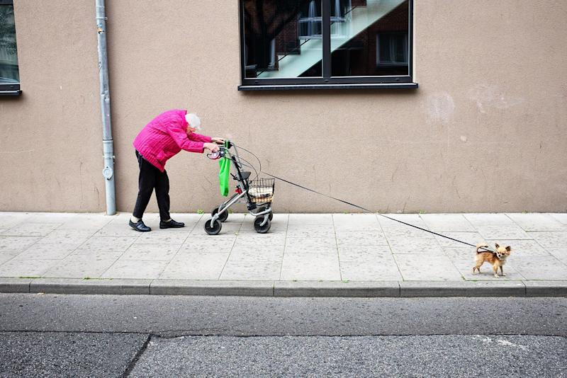 The most graceful lady of her neighborhood in Hamburg, Germany -- always stylish, colorful, in good spirits, smiling, never complaining, even through everyday struggles. She is never seen without her best friend – her little dog.