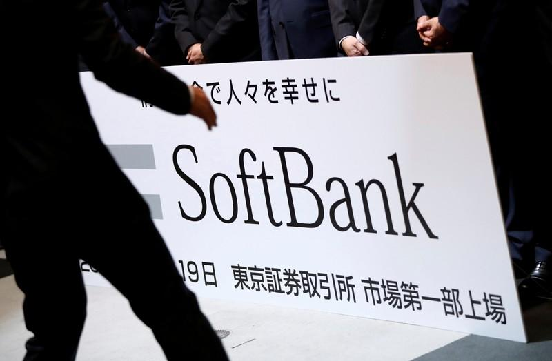 FILE PHOTO: SoftBank Corp placard is prepared during a ceremony to mark the company's debut on the Tokyo Stock Exchange in Tokyo