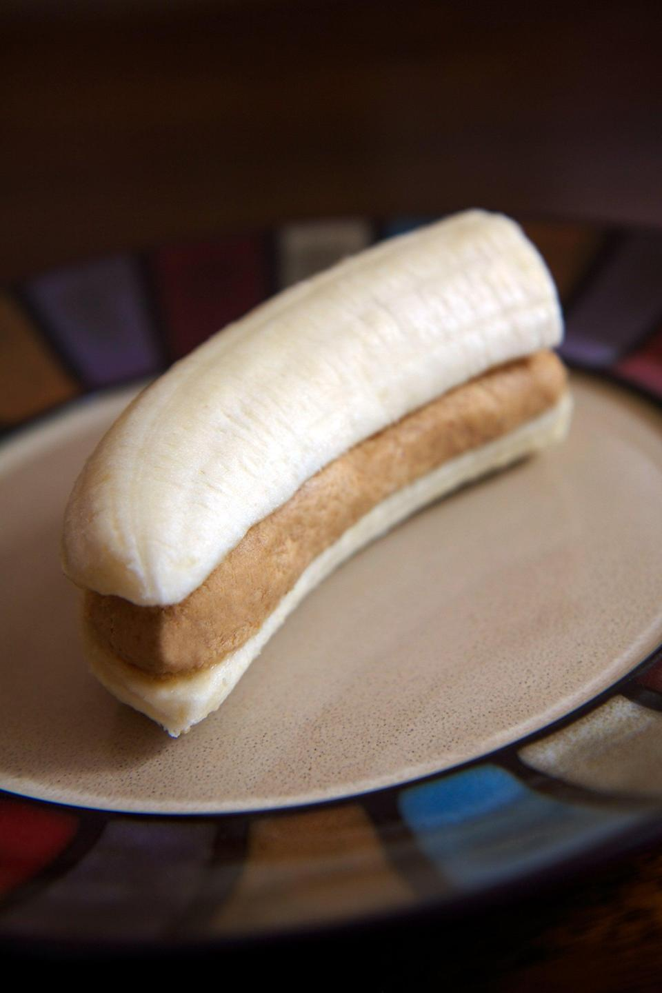 """<p>Banana and peanut butter get a protein upgrade with this quick snack. </p> <p><strong>Get the recipe:</strong> <a href=""""https://www.popsugar.com/fitness/High-Protein-Banana-Peanut-Butter-Snack-34280337"""" class=""""link rapid-noclick-resp"""" rel=""""nofollow noopener"""" target=""""_blank"""" data-ylk=""""slk:banana and PB snack"""">banana and PB snack</a></p>"""