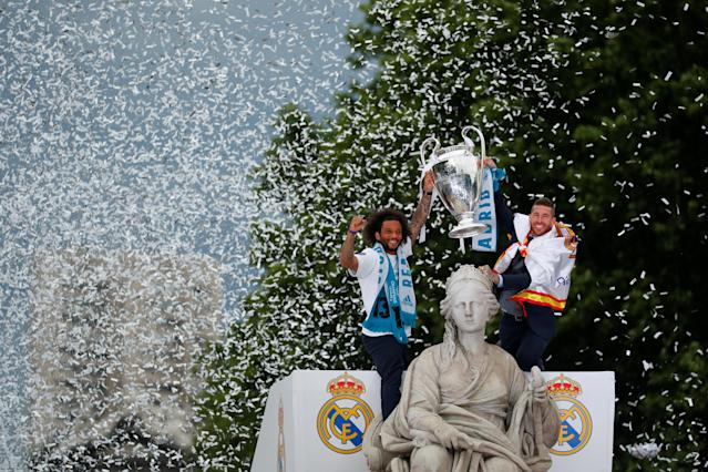 Soccer Football - Real Madrid celebrate winning the Champions League Final - Madrid, Spain - May 27, 2018 Real Madrid's Sergio Ramos and Marcelo celebrate during victory celebrations REUTERS/Paul Hanna