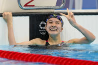 Yui Ohashi, of Japan, reacts after winning the women's 200-meter individual medley final at the 2020 Summer Olympics, Wednesday, July 28, 2021, in Tokyo, Japan. (AP Photo/Martin Meissner)