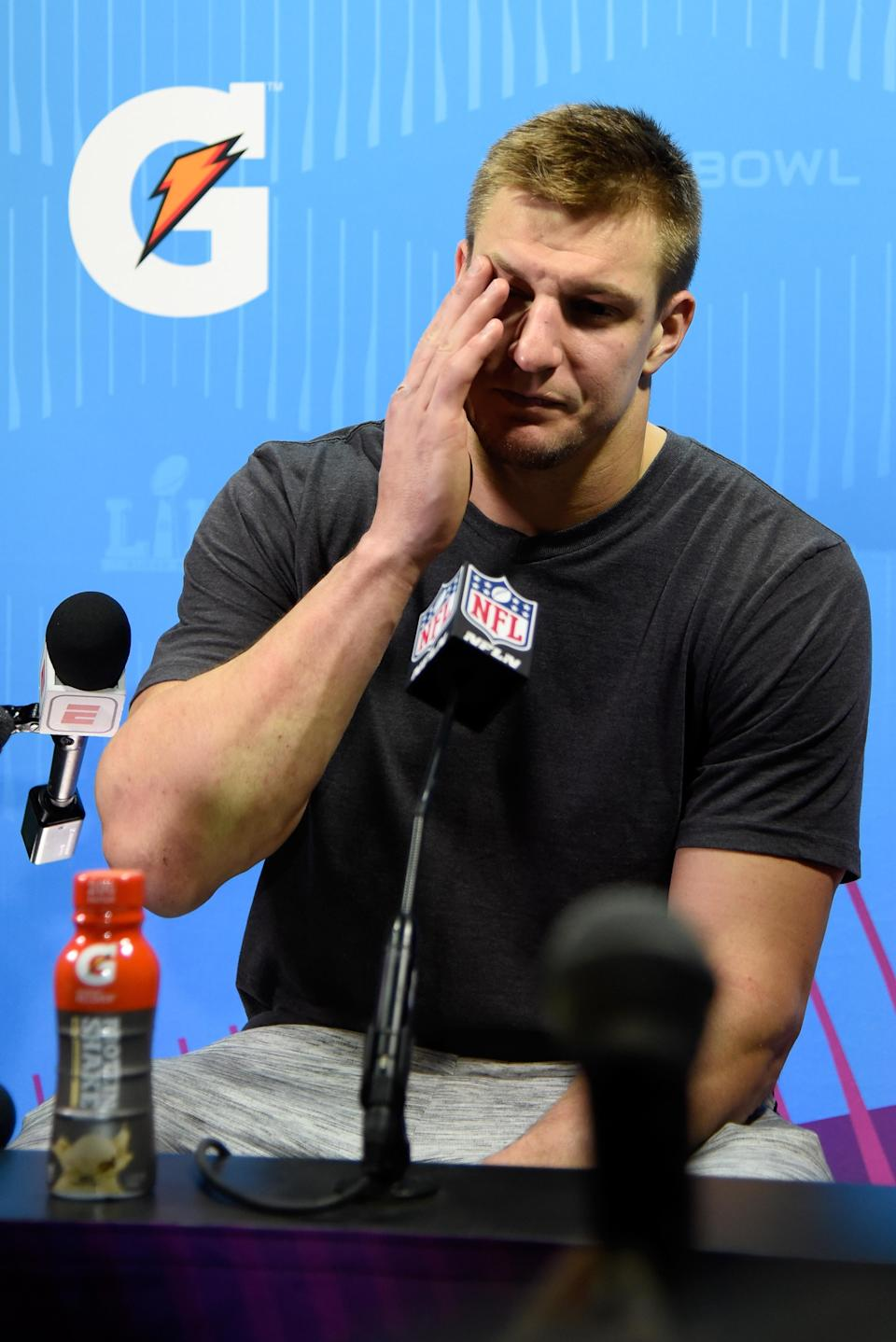 <p>Rob Gronkowski #87 of the New England Patriots speaks to the media after losing to the Philadelphia Eagles 41-33 in Super Bowl LII at U.S. Bank Stadium on February 4, 2018 in Minneapolis, Minnesota. (Photo by Larry Busacca/Getty Images) </p>