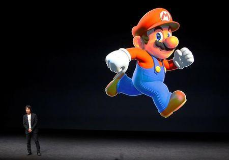 Nintendo Creative Fellow Shigeru Miyamoto stands next to the Super Mario character during an Apple media event in San Francisco, California, U.S. September 7, 2016.  REUTERS/Beck Diefenbach/File Photo