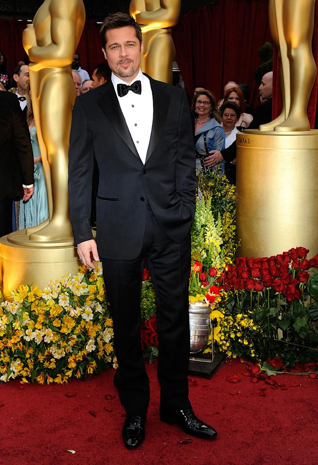 Brad Pitt   Grade: A+       The leading man modeled a classic Tom Ford tux along with his trademark scruff and smirk.