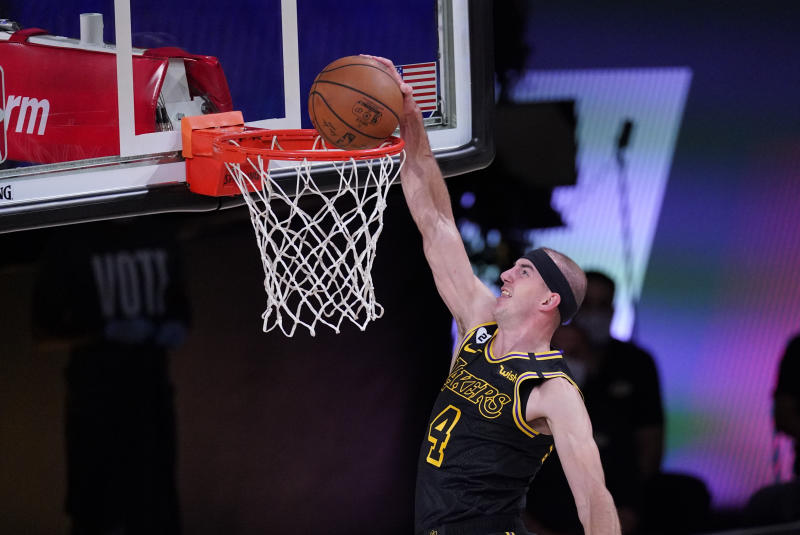 Los Angeles Lakers' Alex Caruso dunks the ball during the first half of an NBA conference final playoff basketball game against the Denver Nuggets Sunday, Sept. 20, 2020, in Lake Buena Vista, Fla. (AP Photo/Mark J. Terrill)