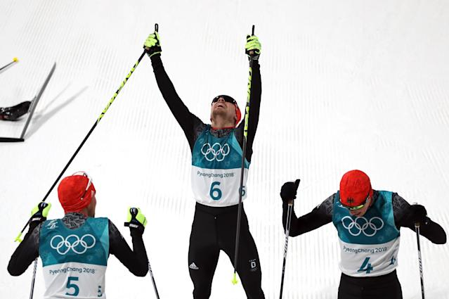 Nordic Combined Events - Pyeongchang 2018 Winter Olympics - Men's Individual 10 km Final - Alpensia Cross-Country Skiing Centre - Pyeongchang, South Korea - February 20, 2018 - Johannes Rydzek of Germany, Fabian Riessle of Germany and Eric Frenzel of Germany celebrate. REUTERS/Carlos Barria