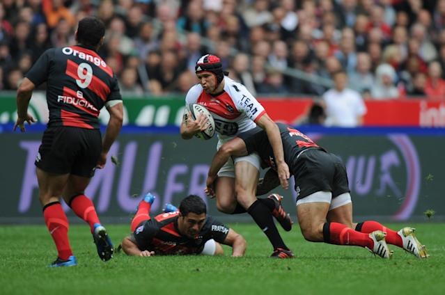 Toulon's Australian centre Matthew Giteau is tackled by Toulouse's players during the French Top 14 rugby union final match Toulouse vs Toulon, on June 9, 2011 at the Stade de France in Saint-Denis, outside Paris. AFP PHOTO / FRED DUFOURFRED DUFOUR/AFP/GettyImages