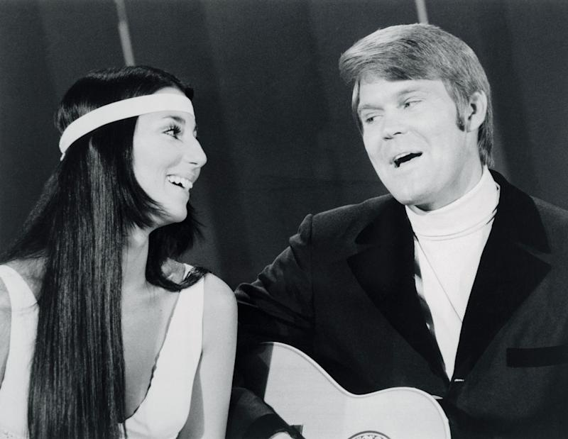 (Original Caption) Cher, of Sonny and Cher, sings a duet with Glen Campbell during a guest appearance on the Glen Campbell Goodtime Hour TV show.
