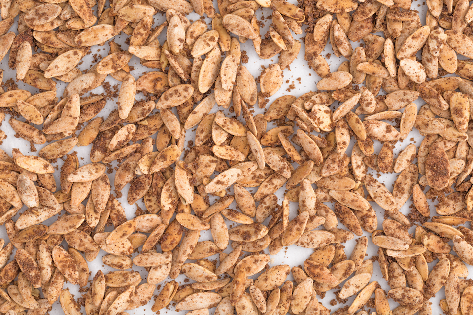 """<p>Brown sugar adds a caramel-esque sweetness to this snack.</p><p>Get the recipe from <a href=""""https://www.delish.com/cooking/recipe-ideas/recipes/a44061/pumpkin-pie-flavored-pumpkin-seeds/"""" rel=""""nofollow noopener"""" target=""""_blank"""" data-ylk=""""slk:Delish"""" class=""""link rapid-noclick-resp"""">Delish</a>.</p><p><a class=""""link rapid-noclick-resp"""" href=""""https://www.amazon.com/Calphalon-Nonstick-Bakeware-Baking-2-Piece/dp/B008BUKO6G/?tag=syn-yahoo-20&ascsubtag=%5Bartid%7C1782.g.3490%5Bsrc%7Cyahoo-us"""" rel=""""nofollow noopener"""" target=""""_blank"""" data-ylk=""""slk:BUY NOW"""">BUY NOW</a> <strong><em>Calphalon Nonstick Bakeware, $30, amazon.com</em></strong></p>"""