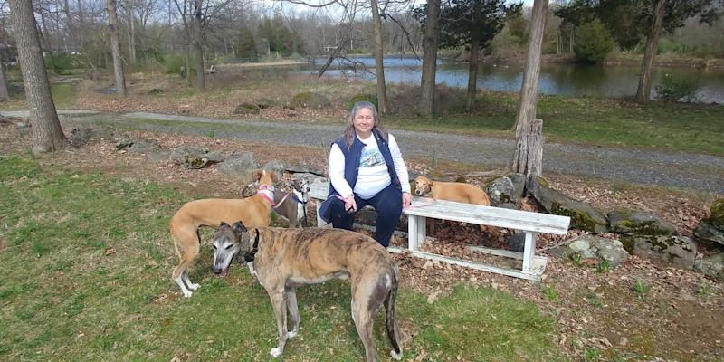 Anne Thimm, a retired analyst from Alexandria, Virginia, is happy that the Mustang Mach-E will keep her dogs: Truman, a retired racing greyhound; Tina, a Spanish galgo; and Whippets, Bambi and Remi. The photo was taken in Lake Anna, Virginia in 2017.