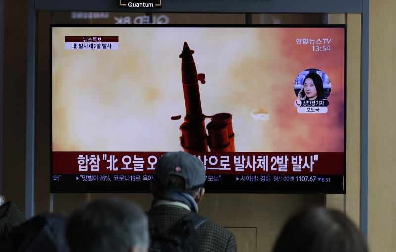 "People watch a TV screen showing a news program reporting about North Korea's firing of projectiles with a file image at the Seoul Railway Station in Seoul, South Korea, Monday, March 2, 2020. North Korea fired two unidentified projectiles into its eastern sea on Monday as it begins to resume weapons demonstrations after a months-long hiatus that could have been forced by the coronavirus crisis in Asia. The Korean letters read: ""Joint Chiefs of Staff, North Korea fired two projectiles."" (AP Photo/Lee Jin-man)"
