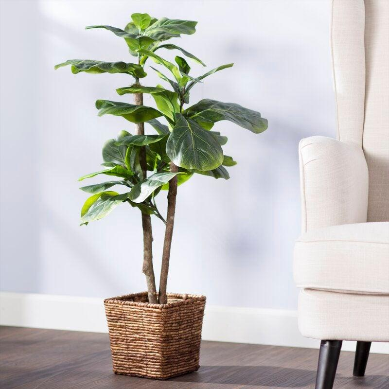 "This gorgeous Tree in a Basket brings the beauty of nature right into your home office space. <br><br><strong><em><a href=""https://www.wayfair.com/brand/bnd/beachcrest-home-b37308.html"" rel=""nofollow noopener"" target=""_blank"" data-ylk=""slk:Shop Wayfair"" class=""link rapid-noclick-resp"">Shop Wayfair</a></em></strong> <br><br><strong>Beachcrest Home</strong> Foliage Tree in Basket, $, available at <a href=""https://go.skimresources.com/?id=30283X879131&url=https%3A%2F%2Fwww.wayfair.com%2Fdecor-pillows%2Fpdp%2Fbeachcrest-home-foliage-tree-in-basket-bcmh1991.html"" rel=""nofollow noopener"" target=""_blank"" data-ylk=""slk:Wayfair"" class=""link rapid-noclick-resp"">Wayfair</a>"