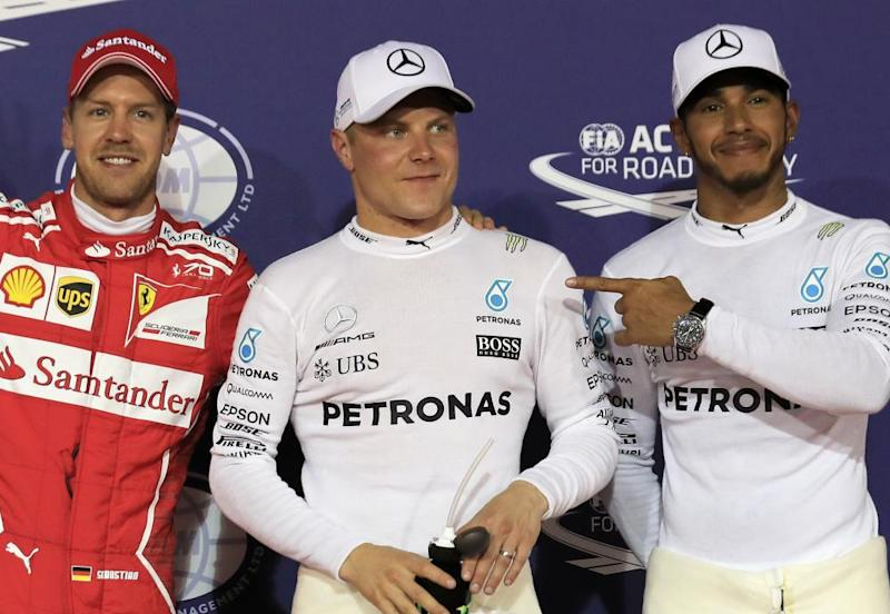 Valtteri Bottas is flanked by Sebastian Vettel and Lewis Hamilton after taking pole.