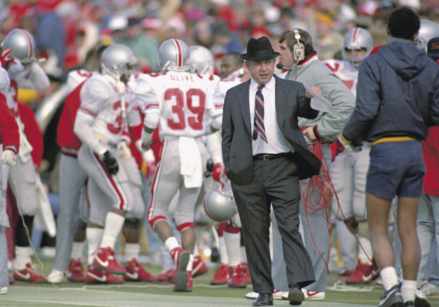FILE - In this Nov. 21, 1987, file photo, Ohio State head coach Earle Bruce gestures on the sidelines during a game against Michigan in Ann Arbor, Mich. Bruce died in Columbus, Ohio at the age of 87, according to a statement released by his daughters through Ohio State on Friday. Hed been suffering from Alzheimers disease. (AP Photo/Robert Kozloff, File)