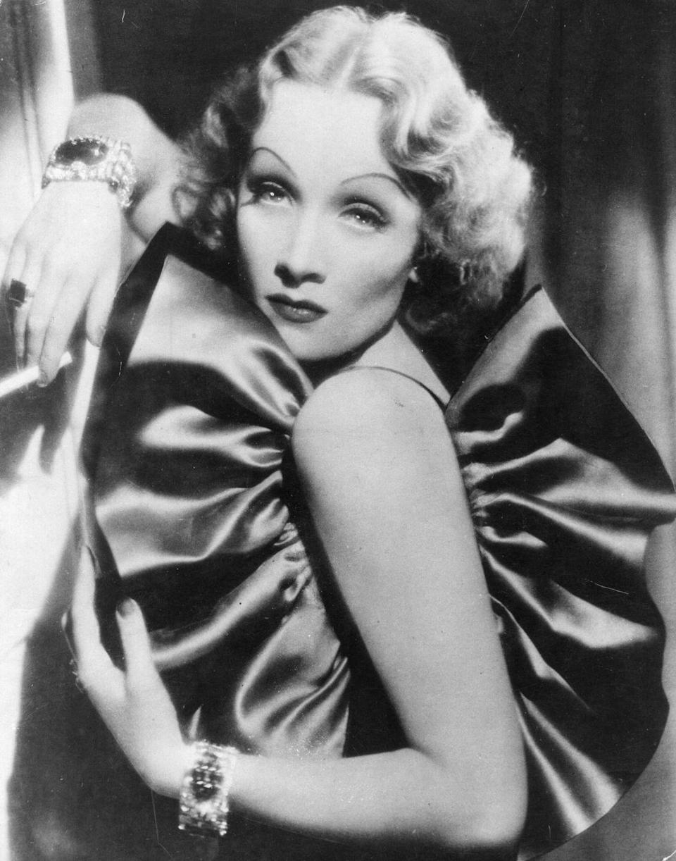 <p>In a still from the film <em>The Devil Is a Woman</em>, which was adapted from the book <em>La Femme et Le Pantin</em> by Pierre Louÿs, Dietrich embodies her singular sultry gaze. <br></p>