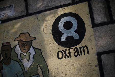 An Oxfam sign is seen on a wall in Corail, a camp for displaced people of the earthquake of 2010, on the outskirts of Port-au-Prince, Haiti, February 17, 2018. REUTERS/Andres Martinez Casares