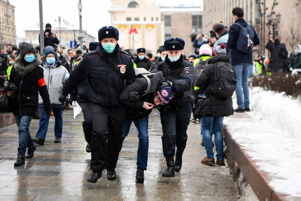Police detain a man during a rally in support of jailed opposition leader Alexei Navalny in downtown MoscowAFP via Getty Images