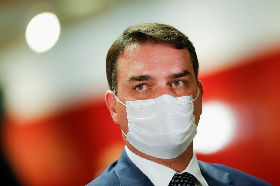 Senator Flavio Bolsonaro looks on after a meeting of the Parliamentary Inquiry Committee (CPI) to investigate government actions and management during the coronavirus disease (COVID-19) pandemic, at the Federal Senate in Brasilia, Brazil June 16, 2021. REUTERS/Adriano Machado