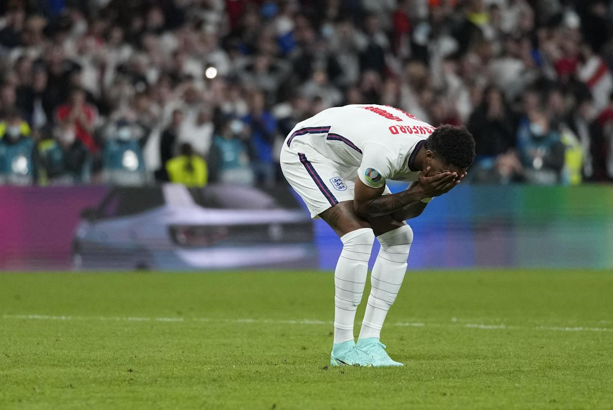 TOPSHOT - England's forward Marcus Rashford reacts after failing to score in the penalty shootout during the UEFA EURO 2020 final football match between Italy and England at the Wembley Stadium in London on July 11, 2021. (Photo by Frank Augstein / POOL / AFP) (Photo by FRANK AUGSTEIN/POOL/AFP via Getty Images)