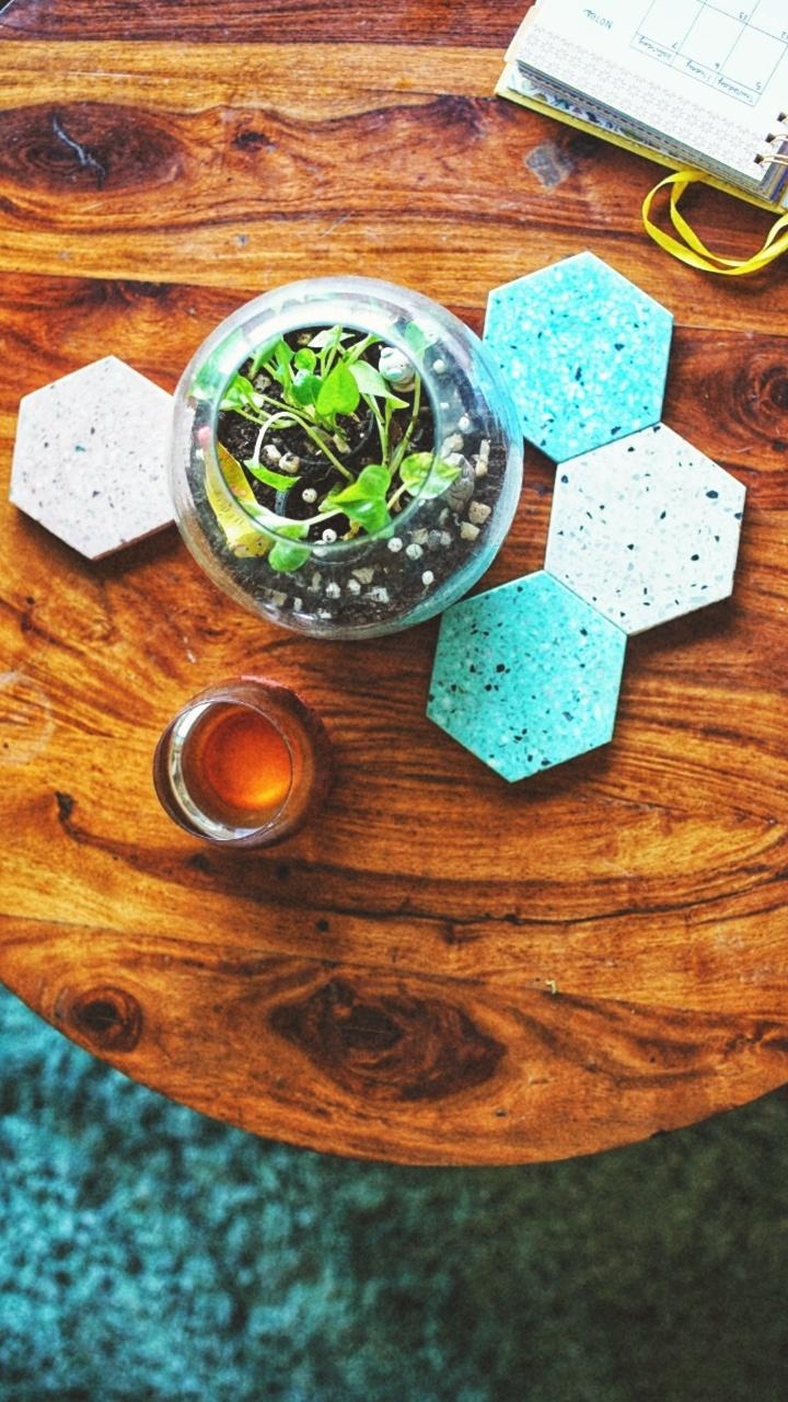 Hexagonal terrazzo coasters echo the teal of the rug, which, incidentally, is one of the cats' favourite lounge spots.