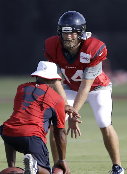 Houston Texans quarterback Ryan Fitzpatrick (14) sets up to receive the ball during NFL football training camp Monday, July 28, 2014, in Houston. The Texans signed Fitzpatrick in the offseason hoping the veteran will help turn around an offense that did very little right last year. (AP Photo/Pat Sullivan)
