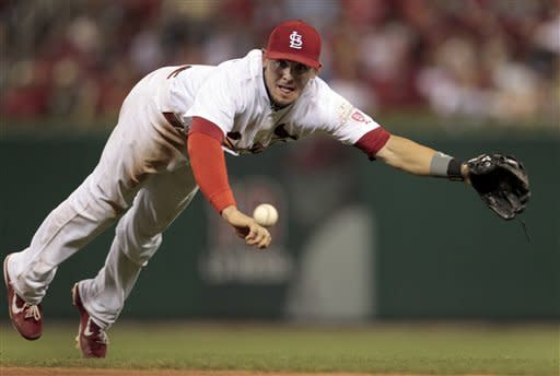 St. Louis Cardinals second baseman Tyler Greene dives but cannot reach a ball hit for an RBI single by Philadelphia Phillies' Placido Polanco during the fifth inning of a baseball game Thursday, May 24, 2012, in St. Louis. (AP Photo/Jeff Roberson)