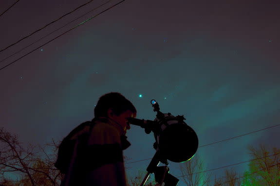 "Night sky watcher Daniel Lanpher sent in a photo of his son, Wes, learning to use the family's telescope in Lansdale PA, a suburb of Philadelphia, taken in early December 2012. Lanpher writes: ""In the image you can see Jupiter and the Pleiades"