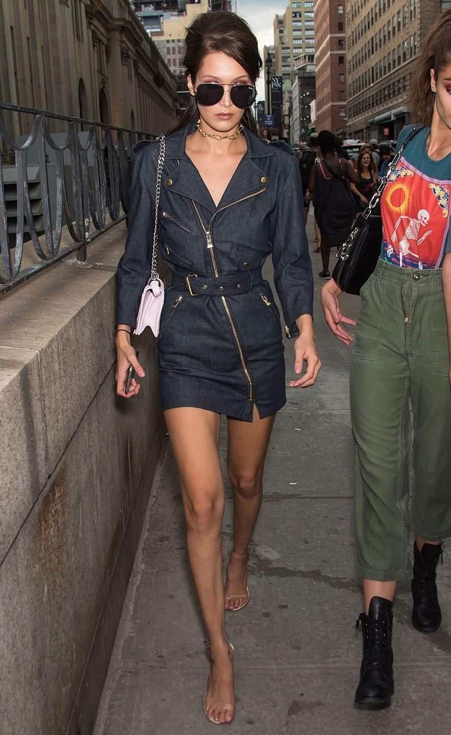 <p>In a denim dress, aviators leaving the Anna Sui fashion show during New York Fashion Week.</p>