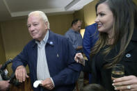 FILE - Former Gov. Edwin Edwards arrives with his wife Trina Edwards, right, to the election night watch party for current Louisiana Gov. John Bel Edwards in Baton Rouge, La., in this Saturday, Nov. 16, 2019, file photo. Edwin Washington Edwards, the high-living four-term governor whose three-decade dominance of Louisiana politics was all but overshadowed by scandal and an eight-year federal prison stretch, died Monday, July 12, 2021 . He was 93. Edwards died of respiratory problems with family and friends by his bedside, family spokesman Leo Honeycutt said. He had suffered bouts of ill health in recent years and entered hospice care this month at his home in Gonzales, near the Louisiana capital. (AP Photo/Matthew Hinton, File)