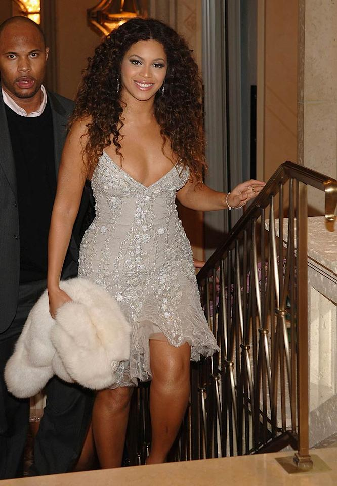 "Beyonce makes an appearance in an attractive cocktail dress and a white fur. Hopefully the songstress' wrap is faux; otherwise, somebody call PETA! Jamie McCarthy/<a href=""http://www.wireimage.com"" target=""new"">WireImage.com</a> - December 31, 2007"