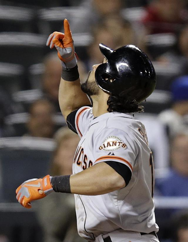 San Francisco Giants' Angel Pagan points to the sky as he crosses the plate after hitting a seventh-inning solo home run off New York Mets relief pitcher Sean Henn in a baseball game Tuesday, Sept. 17, 2013, in New York. (AP Photo/Kathy Willens)