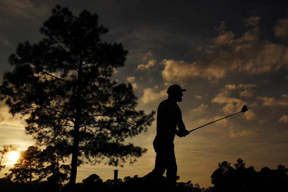 Dustin Johnson watches his shot on the 18th hole during the third round of the Masters golf tournament Saturday, Nov. 14, 2020, in Augusta, Ga. (AP Photo/Matt Slocum)