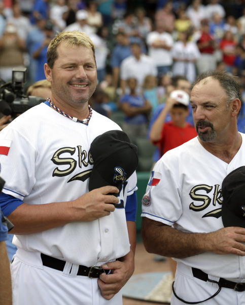 Sugar Land Skeeters pitcher Roger Clemens, left, stands with manager Gary Gaetti, right, before the Skeeters' baseball game against the Bridgeport Bluefish on Friday, Aug. 24, 2012, in Sugar Land, Texas. Clemens, a seven-time Cy Young winner, signed with the Skeeters of the independent Atlantic League this week and is expected to start for the minor league team Saturday at home against Bridgeport. (AP Photo/David J. Phillip)