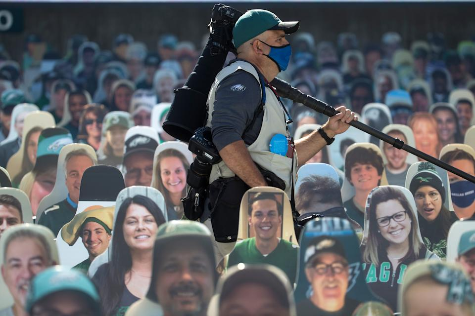 A photographer moves amongst a sea of cardboard cutouts of Eagles fans Sunday, Sept. 20, 2020, at Lincoln Financial Field. The Rams defeated the Eagles 37-19.