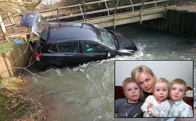 The VW Polo trapped in the water by the ford and Mariel Murphy and her children (SWNS)