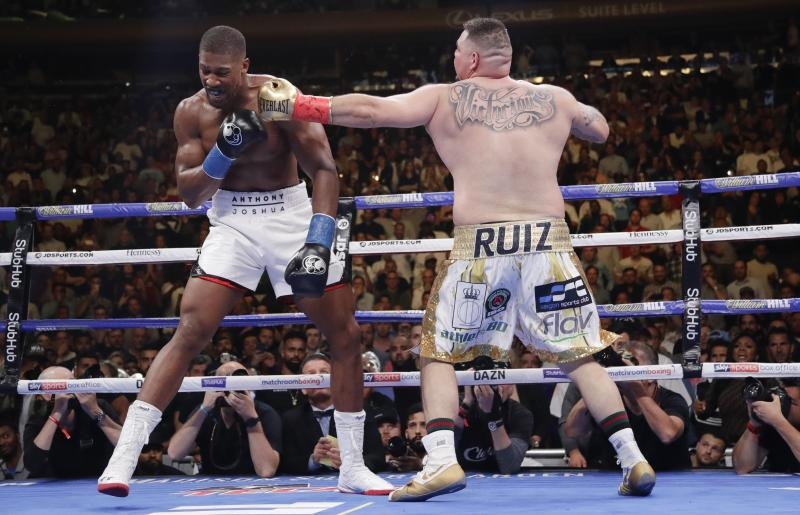 Andy Ruiz, right, punches Anthony Joshua during the third round of a heavyweight title boxing match Saturday, June 1, 2019, in New York. (AP Photo/Frank Franklin II)