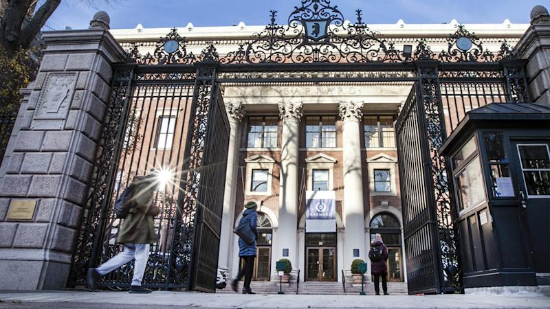 People enter the main gate to Barnard College, in New York's Upper West Side