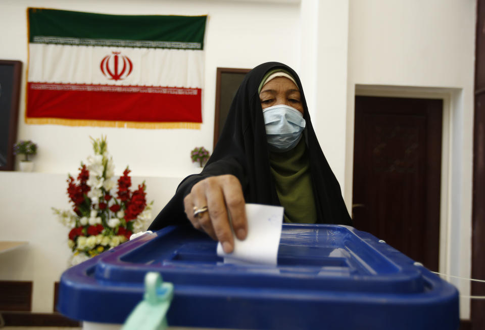An Iranian woman casts his vote during the presidential election at a polling station inside the Iranian consulate in Karbala, Iraq, Friday, June 18, 2021. Iran began voting Friday in a presidential election tipped in the favor of a hard-line protege of Supreme Leader Ayatollah Ali Khamenei, fueling public apathy and sparking calls for a boycott in the Islamic Republic.(AP Photo/Hadi Mizban)