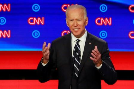 Biden jokes about gaffes with Colbert, gets serious about climate on CNN