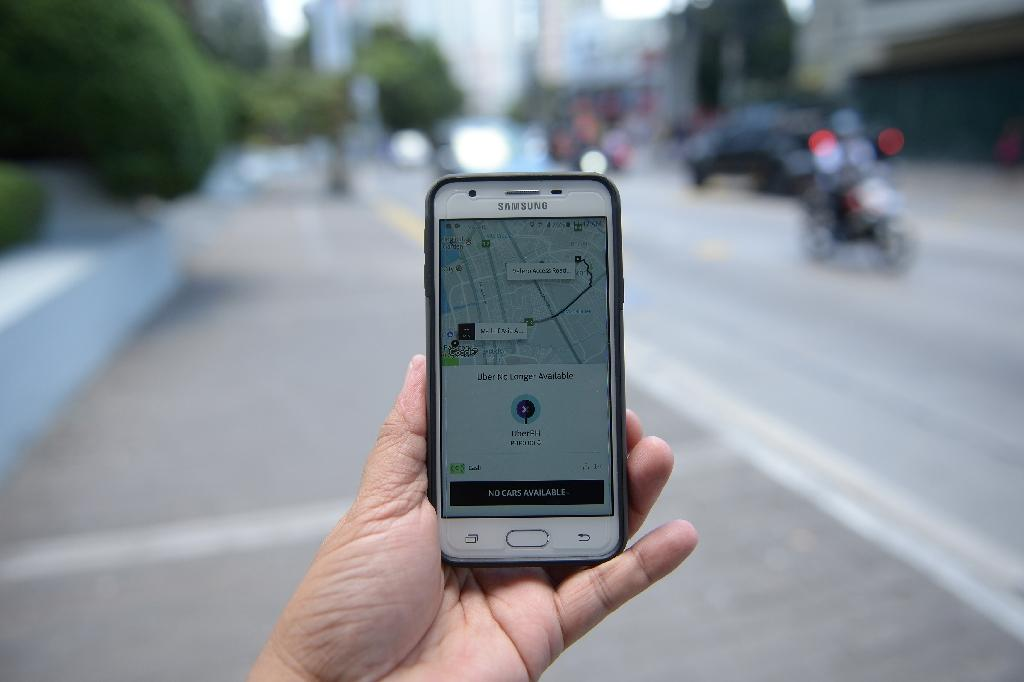 Ride-sharing app Uber faces a month-long suspension in the Philippines, in its latest run-in with authorities around the world (AFP Photo/Ted Aljibe)