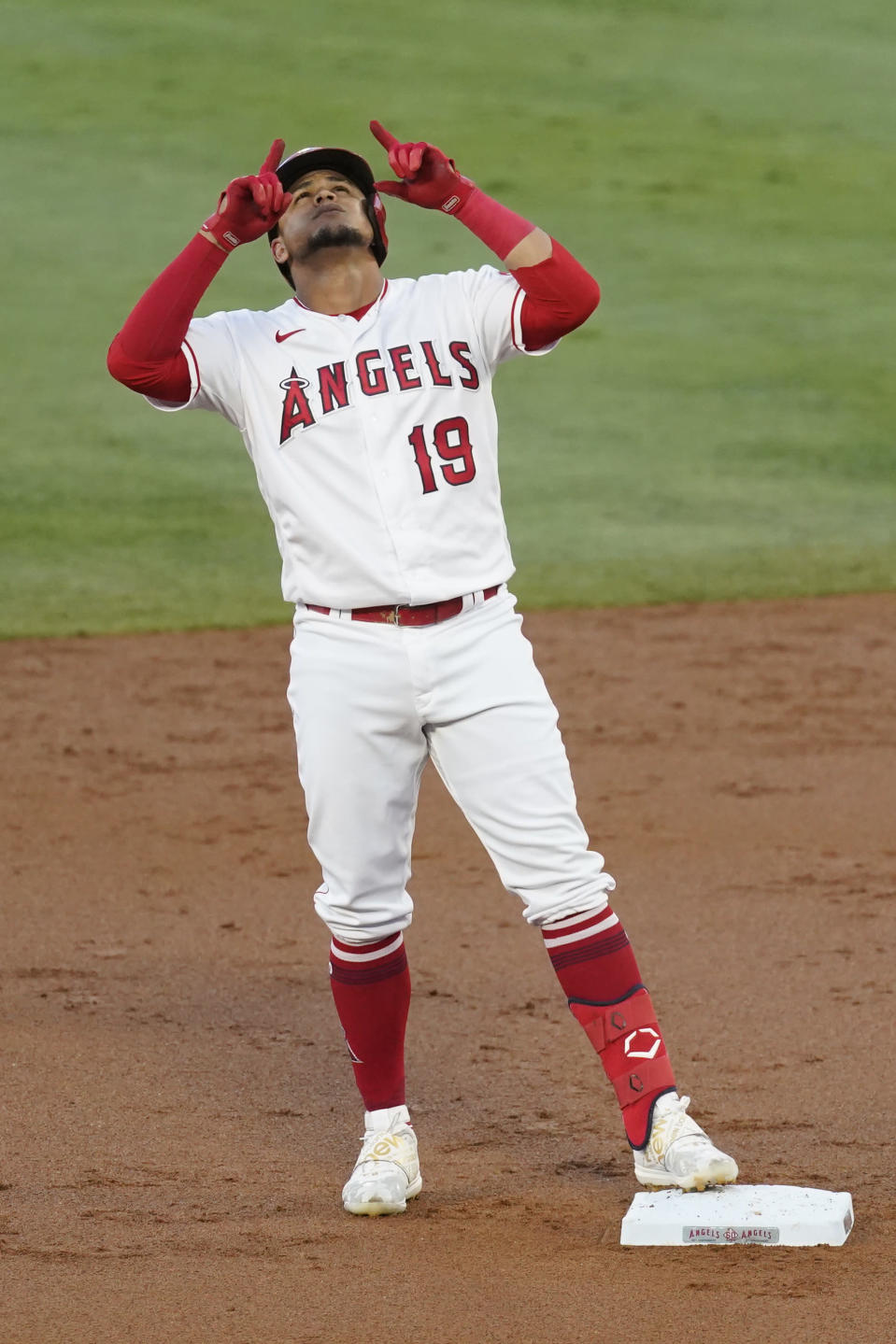 Los Angeles Angels' Juan Lagares (19) celebrates at second base after hitting a double during the second inning of a baseball game against the Seattle Mariners Saturday, June 5, 2021, in Anaheim, Calif. (AP Photo/Ashley Landis)