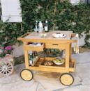 <p>Elevate your outdoor area with a wooden bar cart with all the right fixings for entertaining.</p>