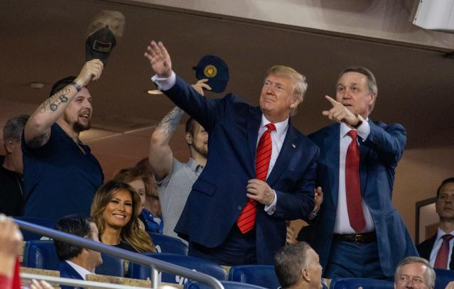 President Trump was a special guest at World Series Game 5, joined by Senator David Perdue of Georgia (right). (Photo by TASOS KATOPODIS/AFP via Getty Images)
