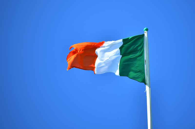 National flag of Ireland flies above the President's residence, ahead of the arrival of Pope Francis, in Dublin