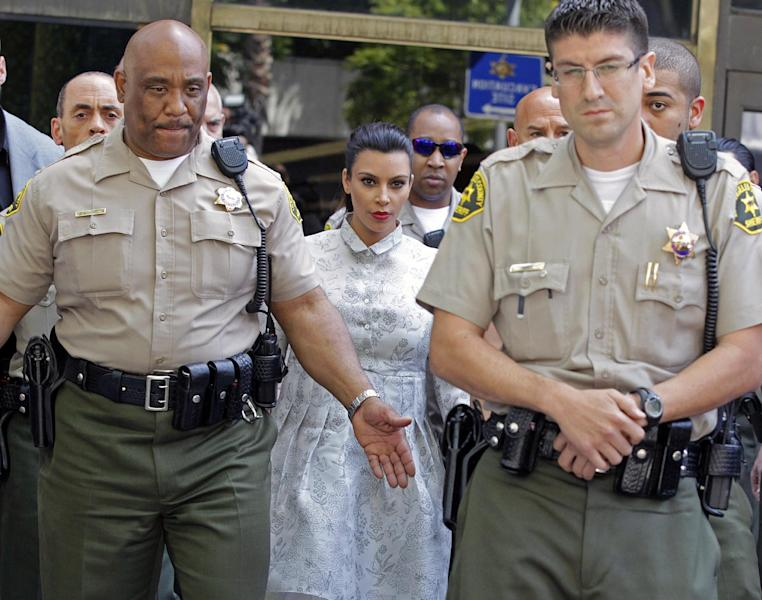TV personality Kim Kardashian leaves Los Angeles County Superior Court after a hearing in her divorce from Kris Humphries, Friday, April 12, 2013. Humphries, a power forward for the Brooklyn Nets, did not attend the hearing. The reality star wants a divorce to end her 72-day marriage to Humphries, but the NBA player wants it annulled. He claims the marriage was based on fraud, but he would have to approve the allegation at trial. Humphries' attorneys declined to comment on settlement discussions Friday but say a May 6 trial date remains. (AP Photo/Reed Saxon)